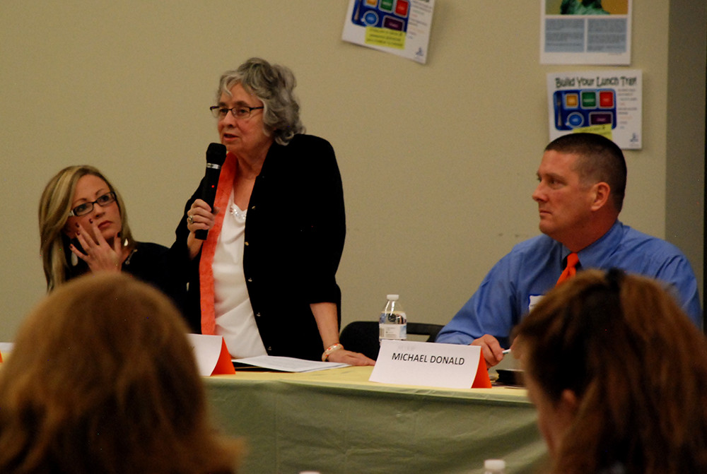 Aurora school board candidates, from left, Monica Colbert, Billie Day, and Mike Donald took questions from parents at a candidate forum Thursday.