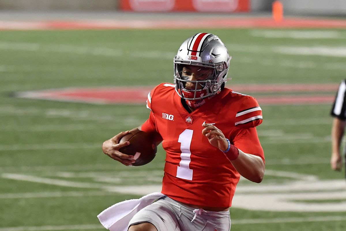 Quarterback Justin Fields of the Ohio State Buckeyes hops into the end zone for a seven yard touchdown run in the second quarter against the Rutgers Scarlet Knights at Ohio Stadium on November 7, 2020 in Columbus, Ohio.