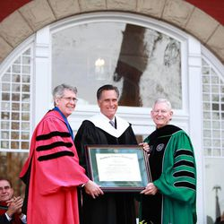 Mitt Romney is presented with an honorary doctorate by Southern Virginia University Provost Madison Sowell and President Paul K. Sybrowsky.