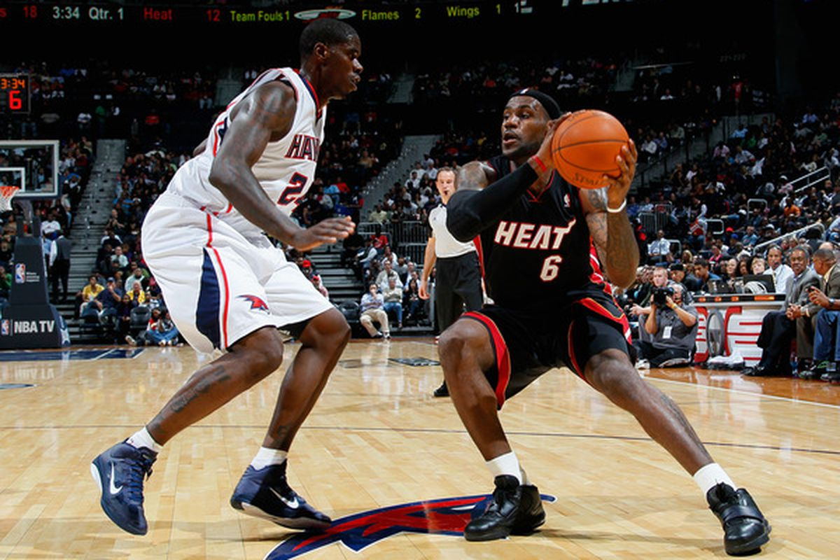 ATLANTA - OCTOBER 21:  LeBron James #6 of the Miami Heat drives against Marvin Williams #24 of the Atlanta Hawks at Philips Arena on Thursday night