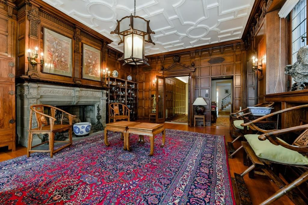 Another view of the large living room, with two doors leading out of it.