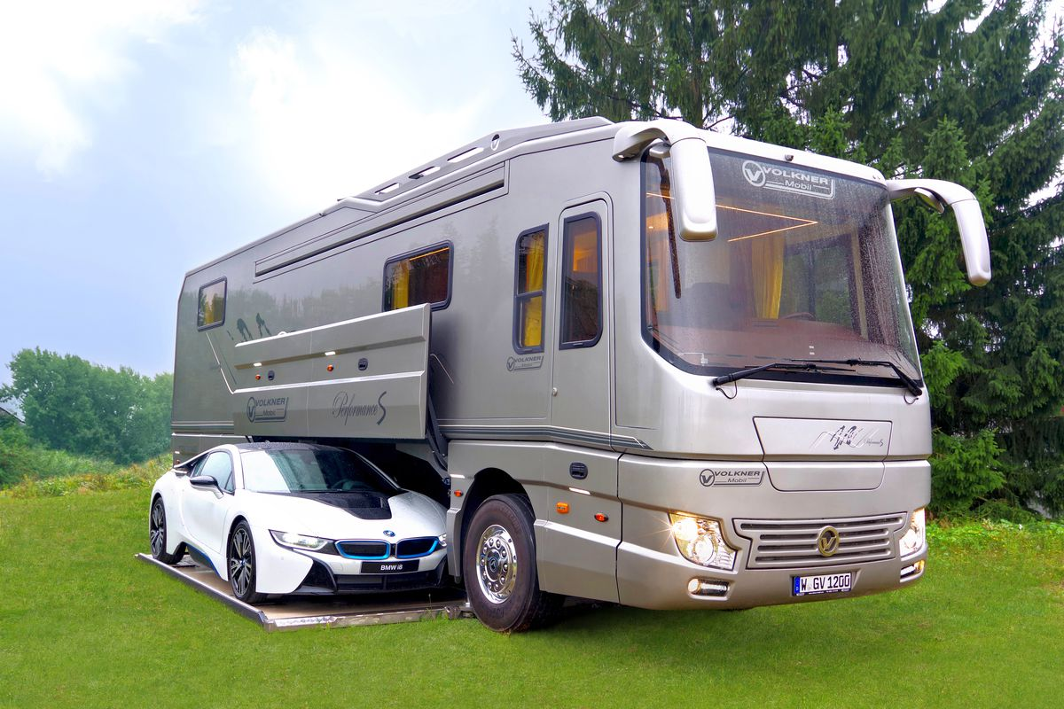 Bespoke rv hides sports car in mobile garage curbed for Class a rv with car garage