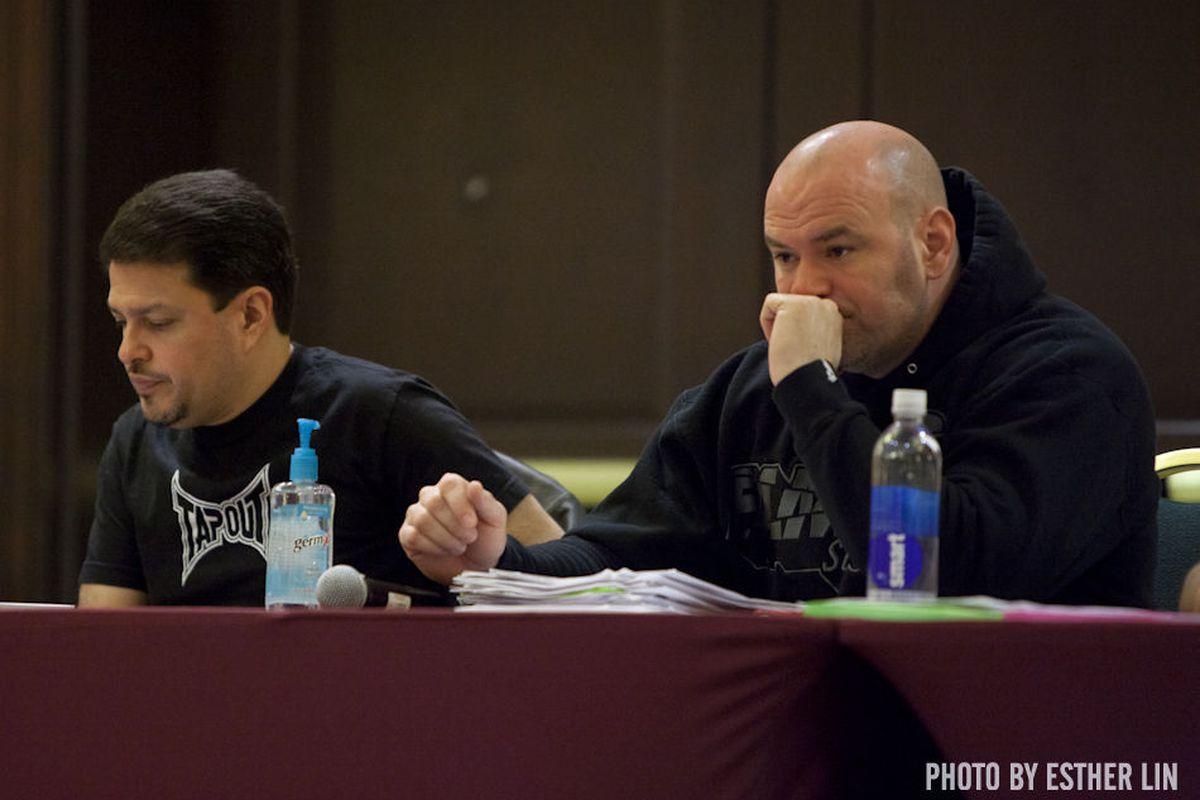 """UFC executives Joe Silva and Dana White. Photo by Esther Lin via <a href=""""http://allelbows.com/blog/wp-content/uploads/2011/04/002_Joe_Silva_and_Dana_White_watch_fighters.jpg"""">allelbows.com</a>"""