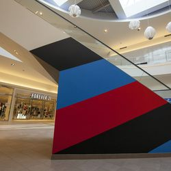 """Longman & Eagle owner Cody Hudson is responsible for this colorblocking escalator work titled """"I'm Still Here (Contemplation Station)."""""""