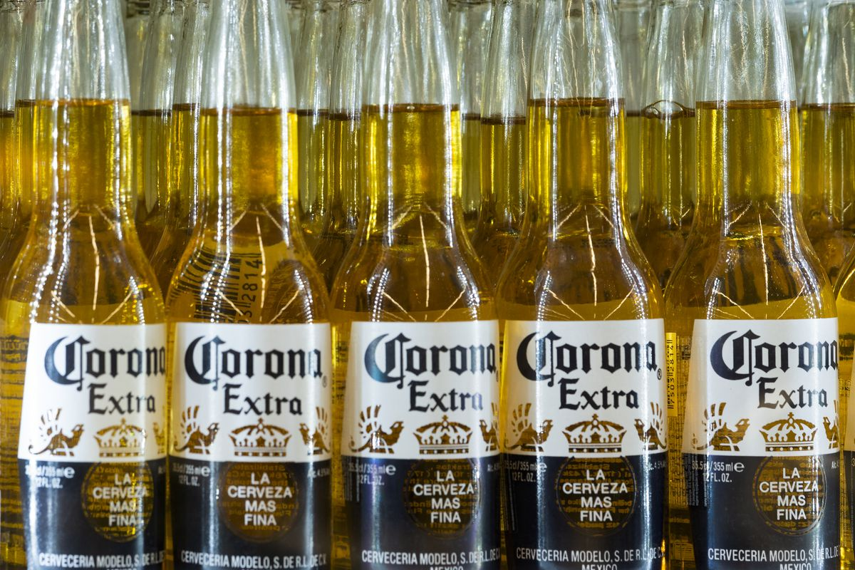 Bottles of Corona beer by Grupo Modelo extra beer are seen...