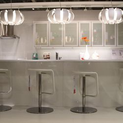 ...or this sleek kitchen. Don't worry though, there's an entire fleet of employees who can help you out, and IKEA actually has a partnership with Whirlpool, so building a custom kitchen for less is a piece of pie.