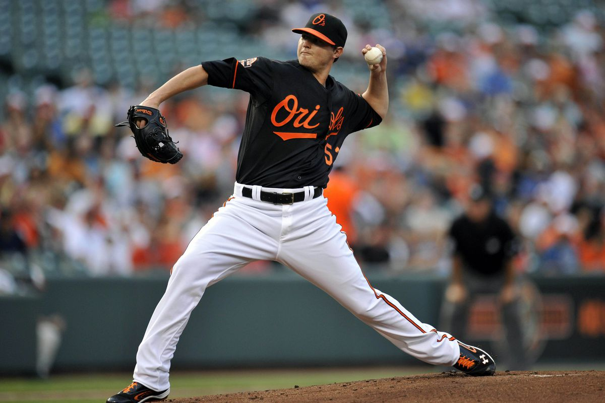 July 27, 2012; Baltimore, MD, USA; Baltimore Orioles starting pitcher Zach Britton (53) pitches in the first inning against the Oakland Athletics at Oriole Park at Camden Yards. Mandatory Credit: Joy R. Absalon-US PRESSWIRE