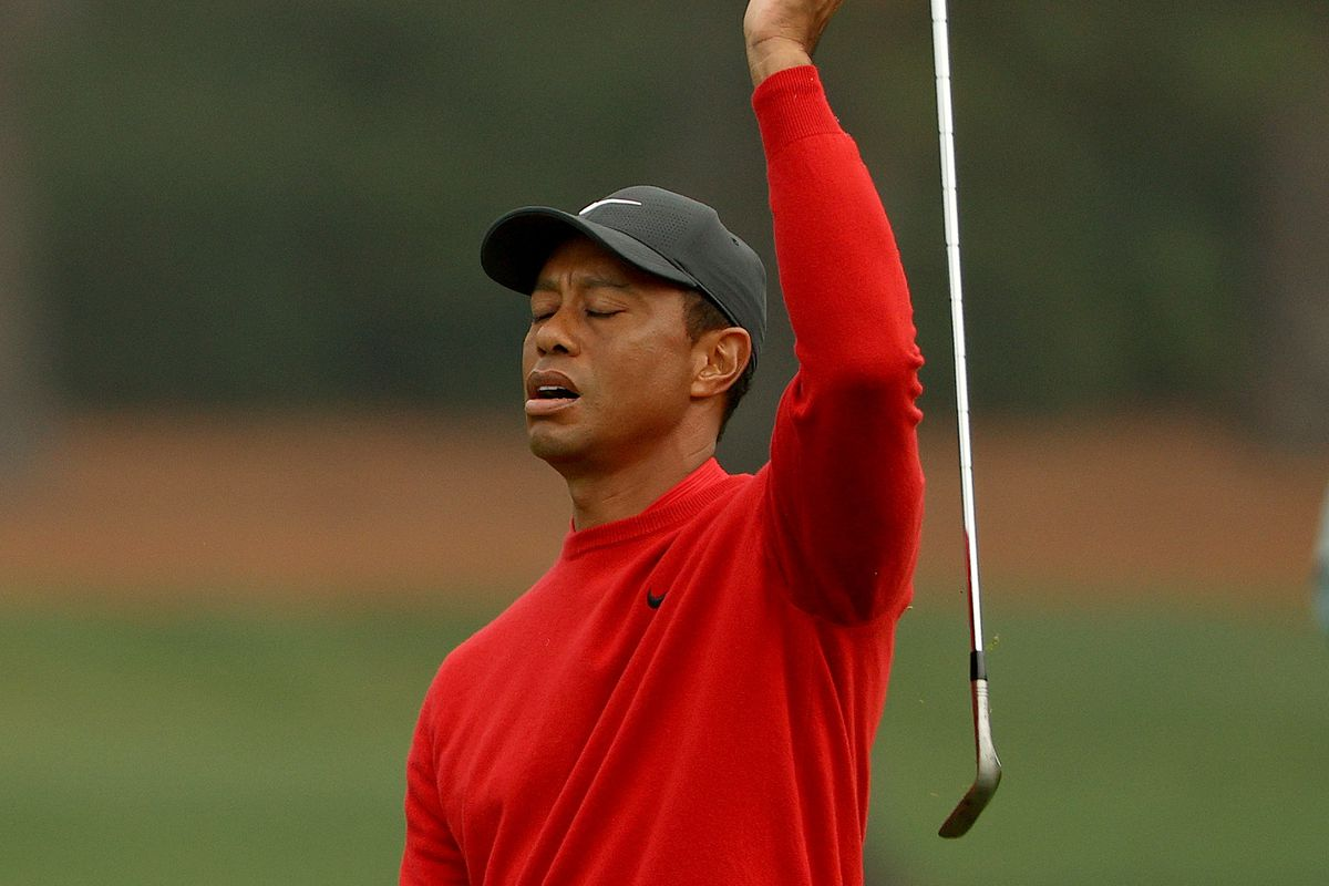 Tiger Woods of the United States reacts to a shot on the second hole during the final round of the Masters at Augusta National Golf Club on November 15, 2020 in Augusta, Georgia.