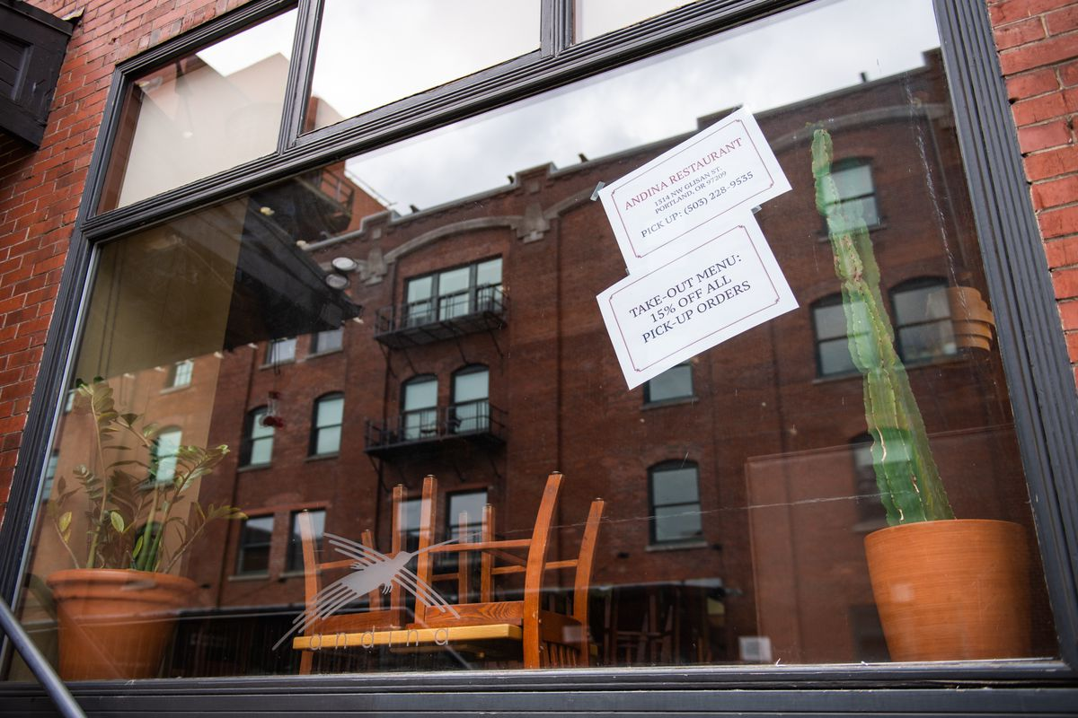 The wooden chairs of this Pearl District Peruvian restaurant sit on the tables, closed to customers for weeks. On the windows, two white signs advertise takeout and delivery orders.