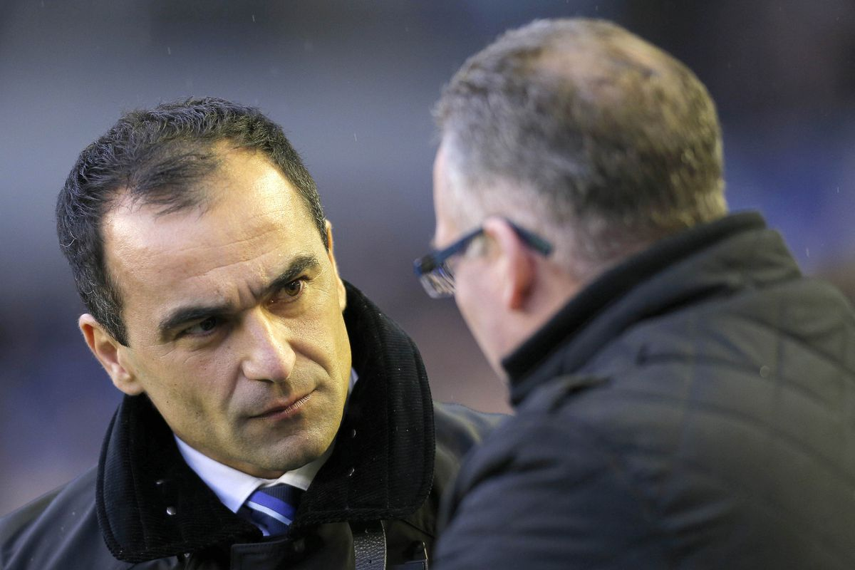 The two managers in early 2014