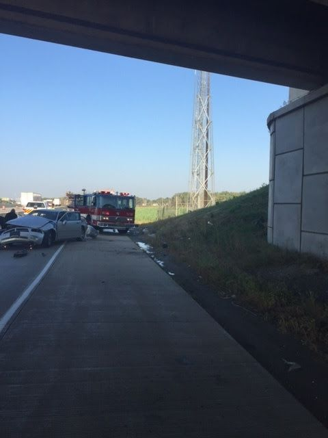 A car fell 23 feet onto an I-80/94 ramp after a shooting that left its driver dead and two passengers injured Sept. 23 in Gary, Indiana.   Indiana State Police