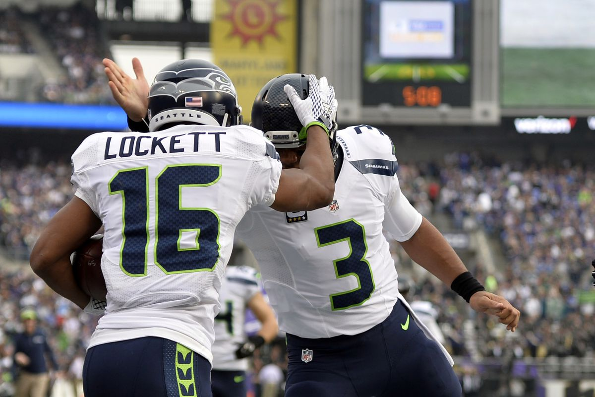 Seattle Seahawks wide receiver Tyler Lockett celebrates with quarterback Russell Wilson after scoring a touchdown during the during the first quarter against the Baltimore Ravens at M&T Bank Stadium.