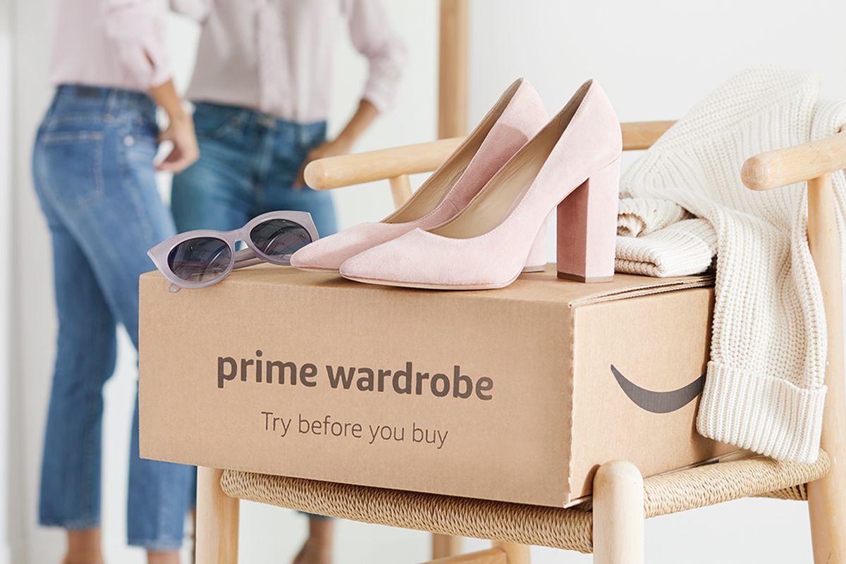 Women's clothing sits atop an Amazon Prime Wardrobe box