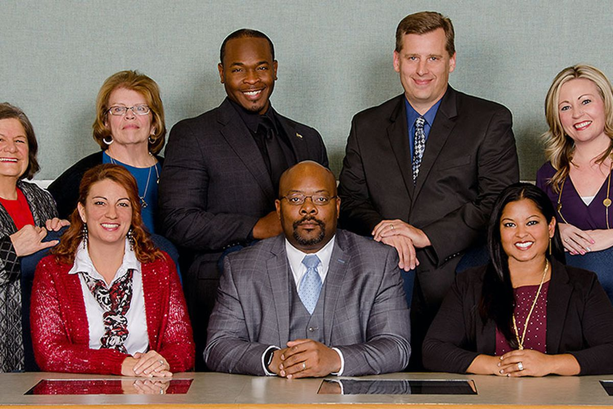 The Aurora school board poses with Superintendent Rico Munn. Eric Nelson is third from the left in the top row. Amber Drevon is first on the left in the bottom row.