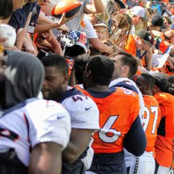 Many, MANY of the Broncos players signed autographs for the fans that came out to Broncos Stadium at Mile High to watch practice.