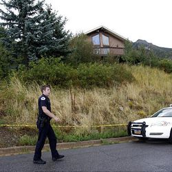 Layton police officer Mike Corry patrols 2184 N. Snoqualmie Circle in Layton on Thursday morning, September 9, 2010.