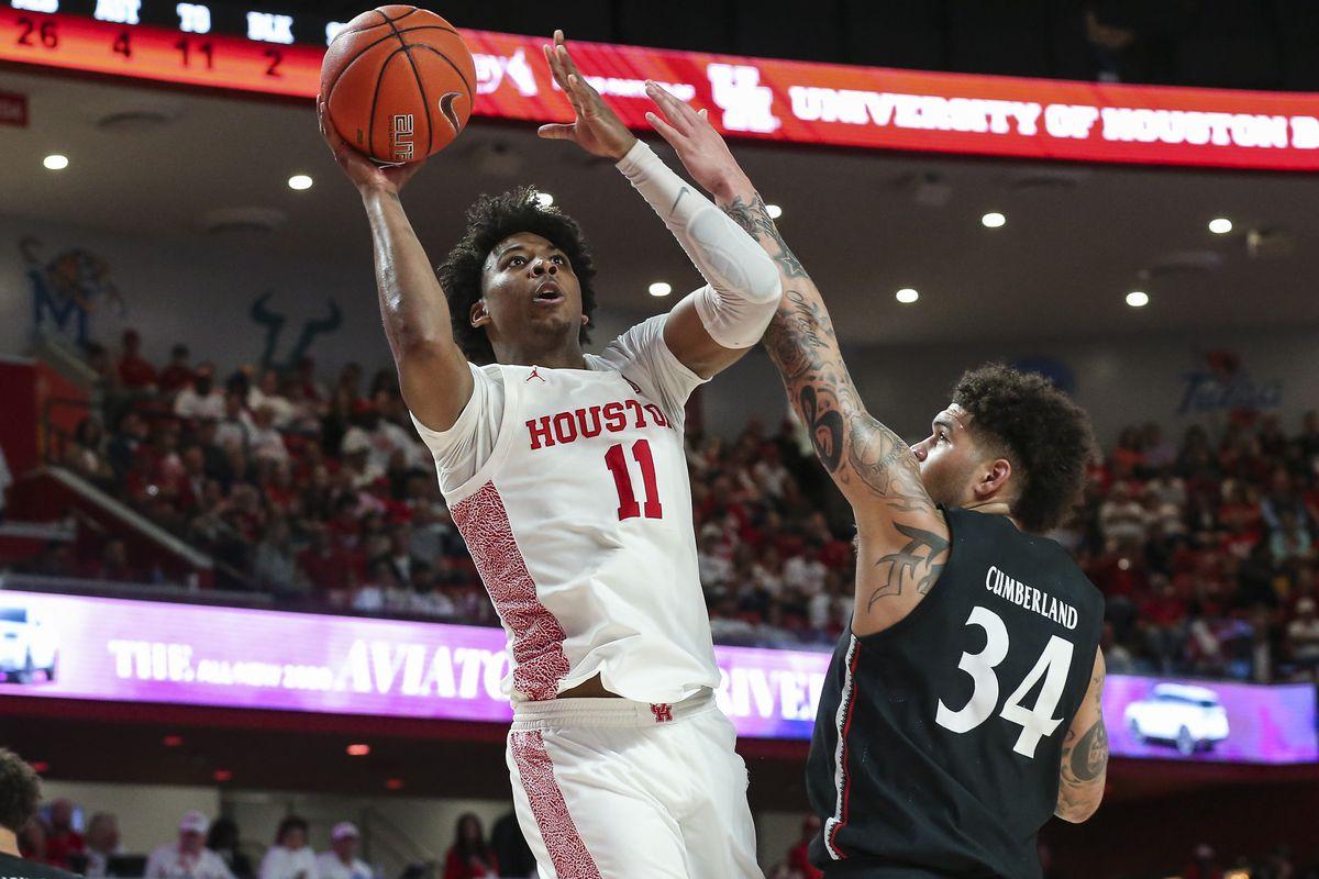 Houston Cougars guard Nate Hinton shoots the ball as Cincinnati Bearcats guard Jarron Cumberland defends during the second half at Fertitta Center.