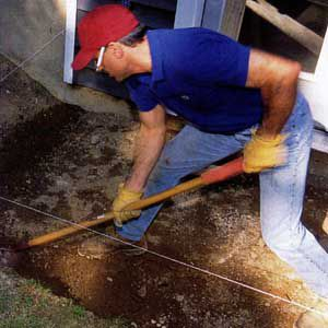 <p>DIG AN 8-in. DEEP TRENCH for the 6 X 6 timbers around the patio perimeter. Align the trench with the batterboard strings.</p>