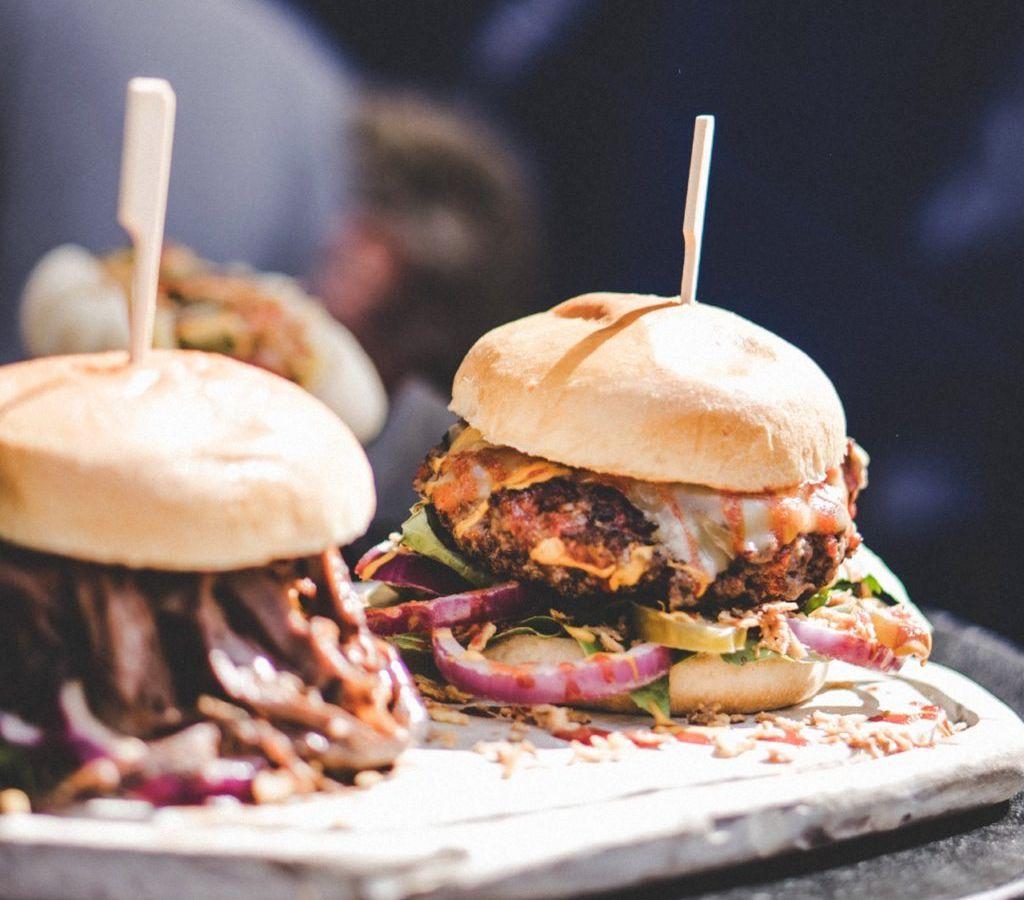 A closeup of veggie burgers on a platter at Plum Bistro