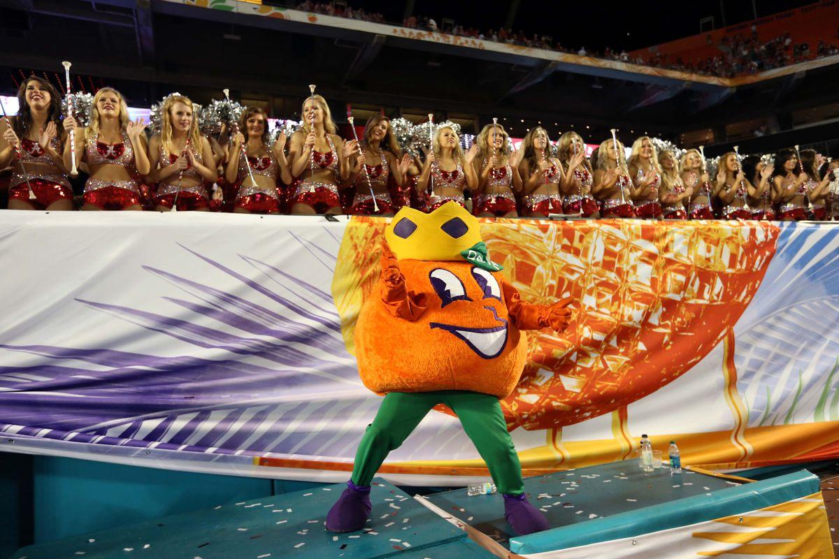Obie stands in front of Alabama cheerleaders, something we may see again soon
