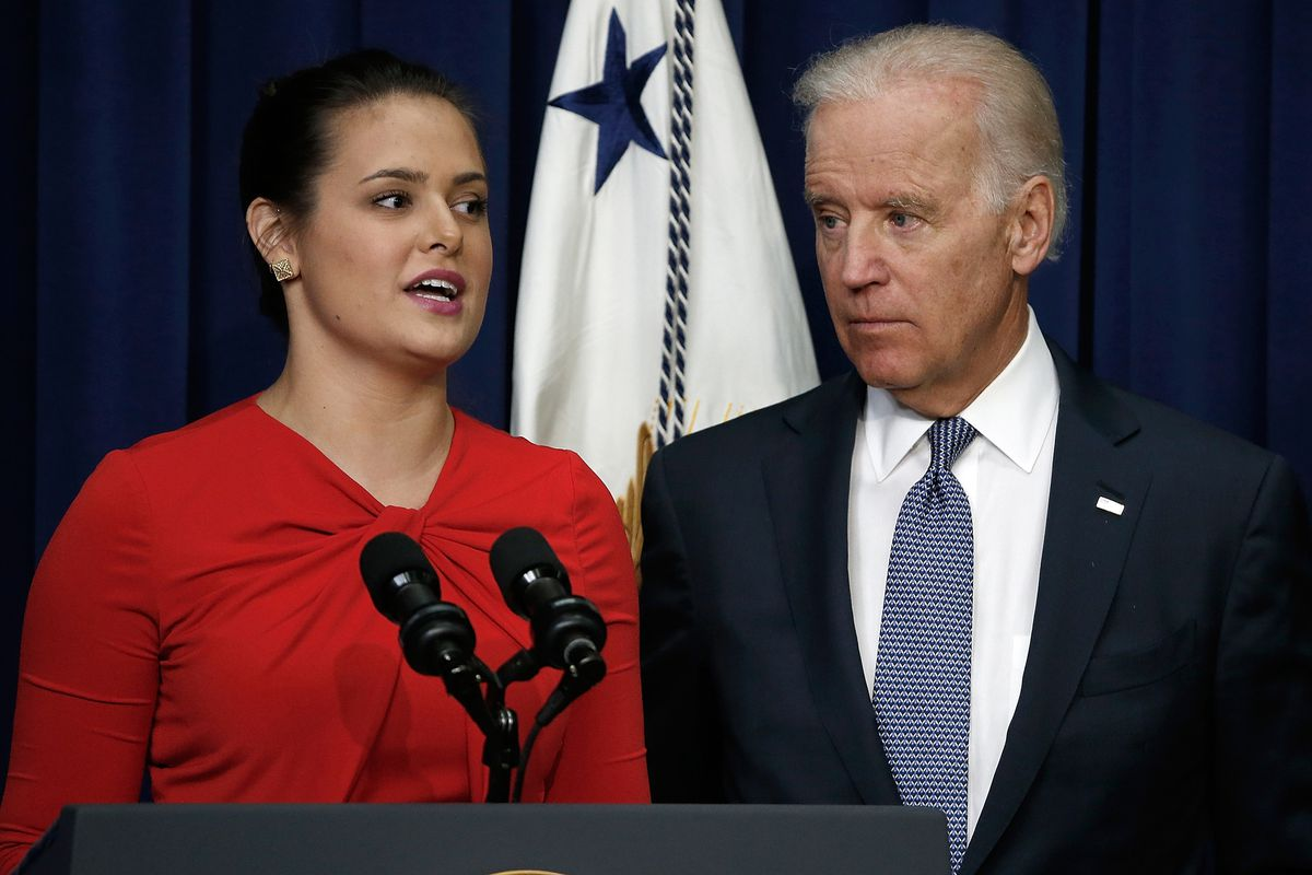 Vice President Joe Biden listens as Madeleine Smith, a graduate of Harvard University who was raped while attending college, speaks during an event.