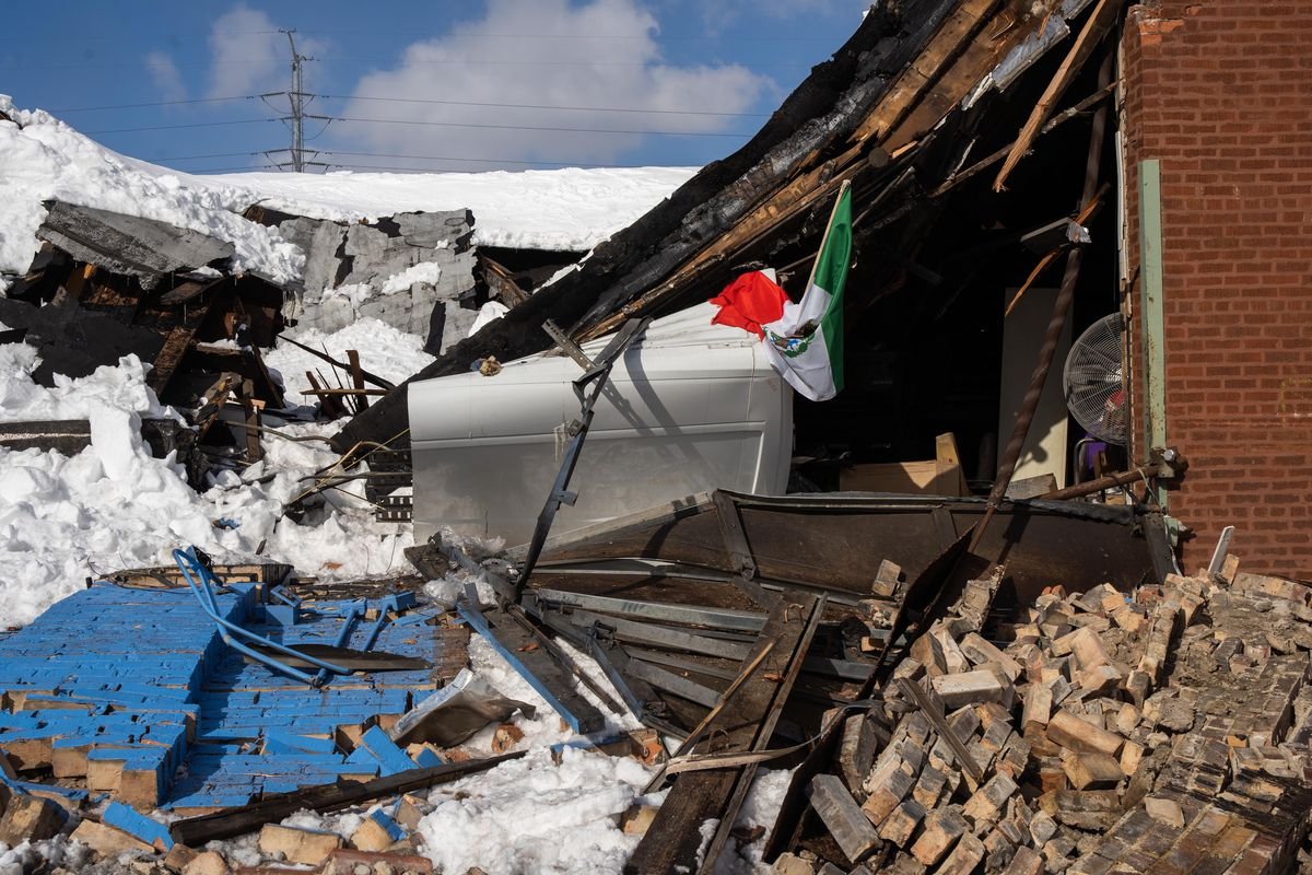 Rubble was strewn around the site of a building collapse Feb. 16 in the 700 block of West 91st Street.