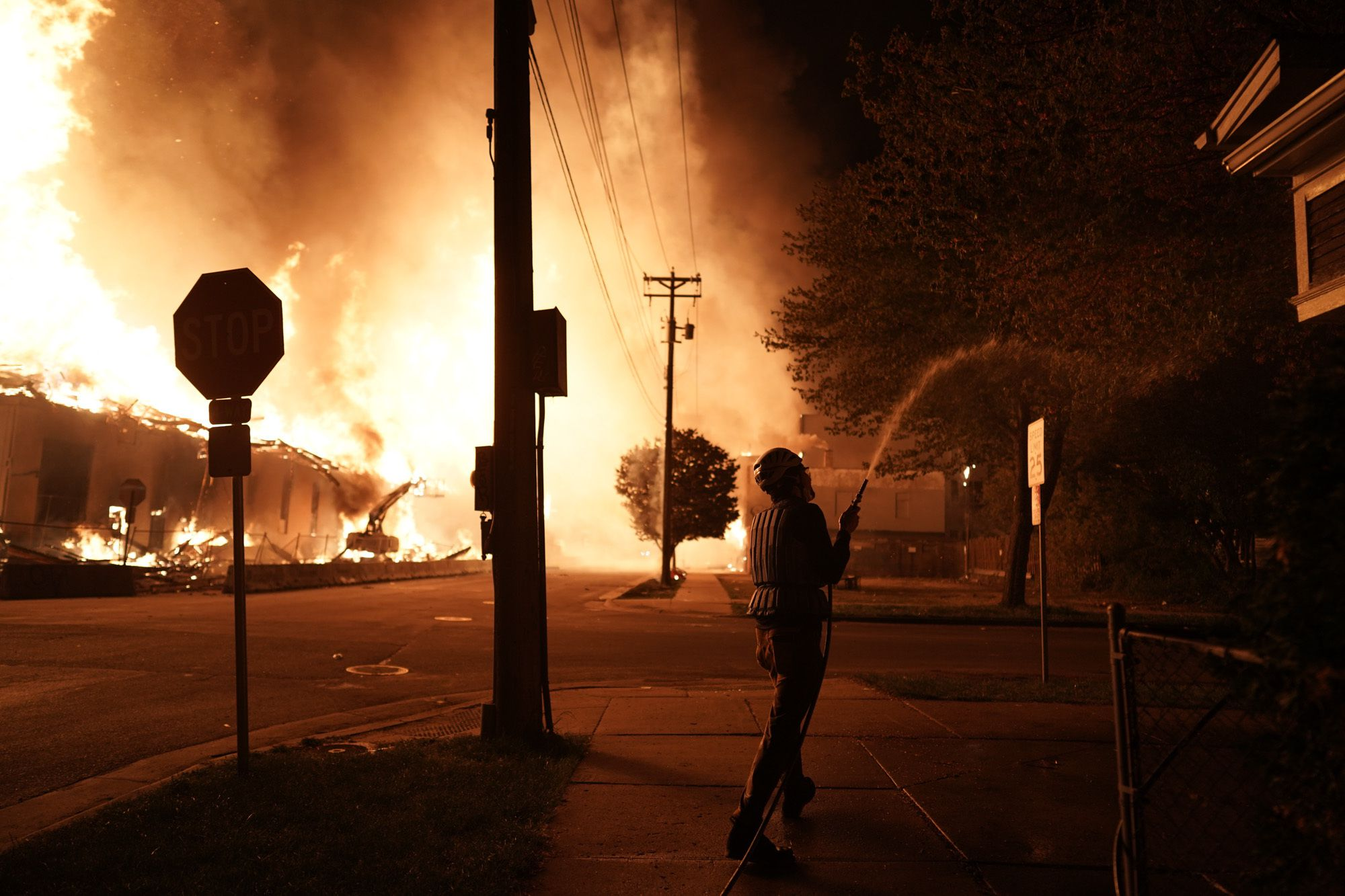 A massive fire engulfed a south Minneapolis building early Thursday as residents frantically tried to hose down nearby houses. Businesses were looted and in flames after protests turned violent.