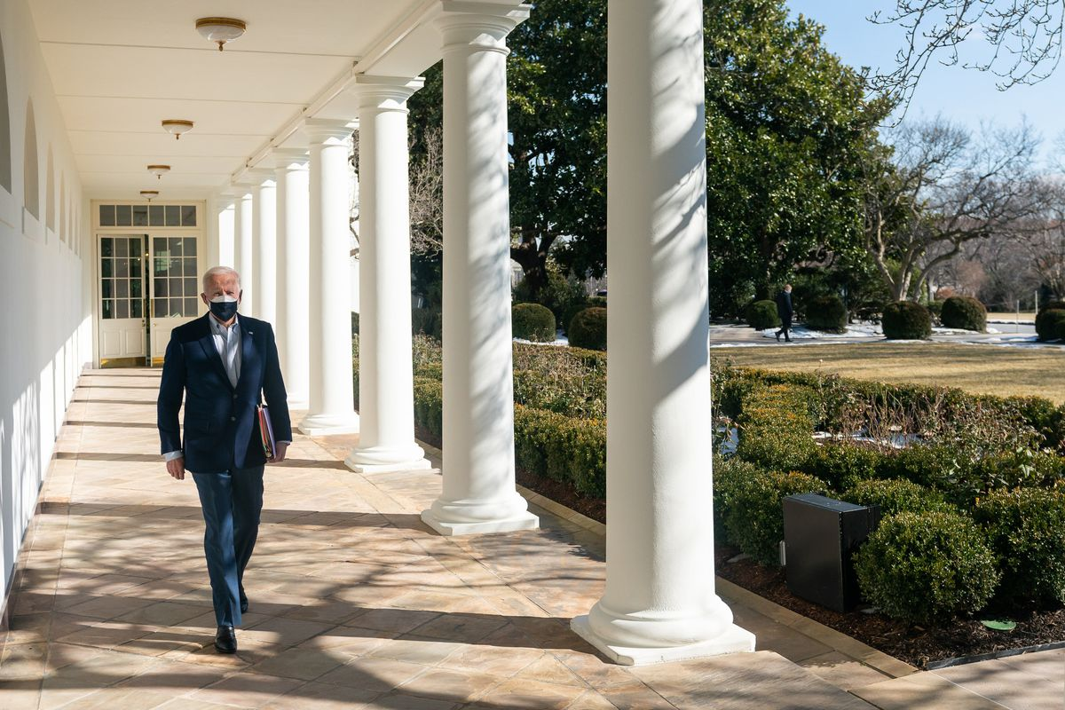 President Joe Biden arrives to the Oval Office Saturday, Feb. 20, 2021, along the West Wing Colonnade of the White House. (Official White House Photo by Adam Schultz)