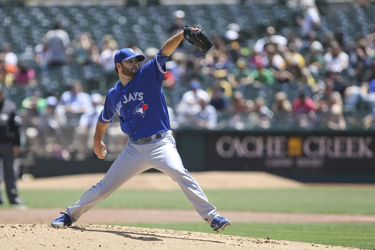 May 9, 2012; Oakland, CA, USA; Toronto Blue Jays starting pitcher Brandon Morrow (23) pitches the ball against the Oakland Athletics during the first inning at O.co Coliseum. Mandatory Credit: Kelley L Cox-US PRESSWIRE