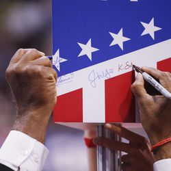 A state banner is signed during the final night of the National Republican Convention in Cleveland on Thursday, July 21, 2016.