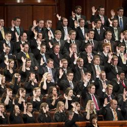 Members of the choir take part in the sustaining vote during the afternoon session Saturday, April 6, 2013 of the 183th Annual General Conference of The Church of Jesus Christ of Latter-day Saints in the Conference Center.