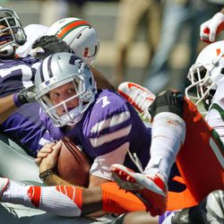 Kansas State quarterback Collin Klein (7) looks for an official's call after crossing the goal line past Miami defensive back Vaughn Telemaque (7) during the second half of an NCAA college football game in Manhattan, Kan., Saturday, Sept. 8, 2012. Kansas State offensive linesman Ethan Douglas (71) begins to celebrate on the play.