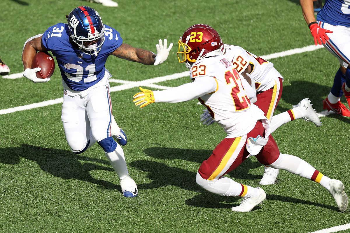 Devonta Freeman #31 of the New York Giants rushes with the ball against the Washington Football Team during their NFL game at MetLife Stadium on October 18, 2020 in East Rutherford, New Jersey.