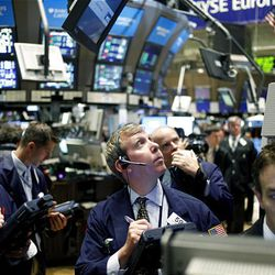 Traders work on the floor of the New York Stock Exchange in New York Monday.