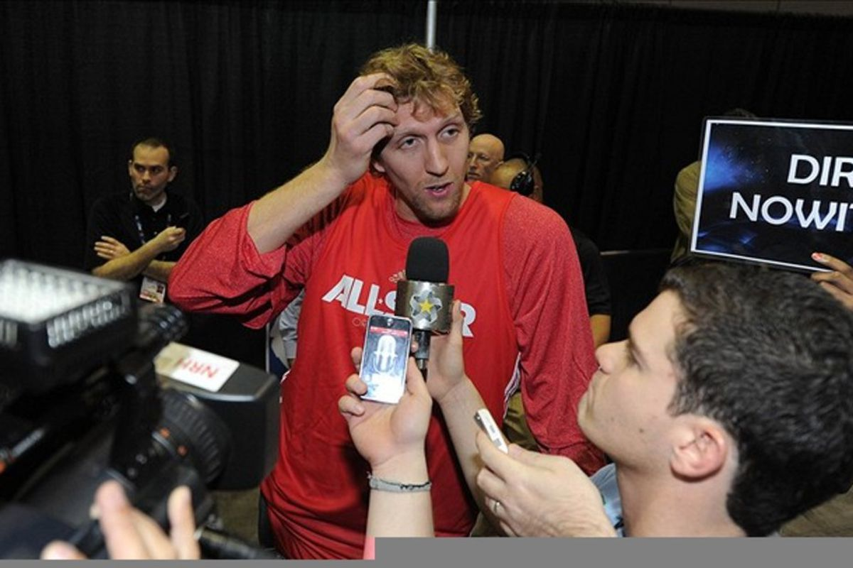 """I don't know why, but seeing that a guy has to hold up a """"DIRK NOWITZKI"""" sign the entire time he talks so everyone knows who he is just cracks me up. Mandatory Credit: Bob Donnan-US PRESSWIRE"""