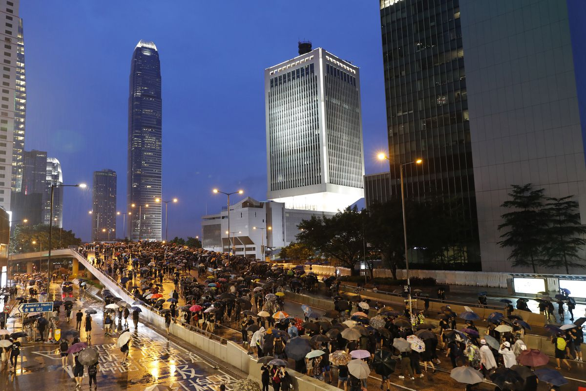 Protesters march in the rain in Hong Kong Sunday, Aug. 18, 2019. Heavy rain fell on tens of thousands of umbrella-toting protesters Sunday as they marched from a packed park and filled a major road in Hong Kong, where mass pro-democracy demonstrations hav
