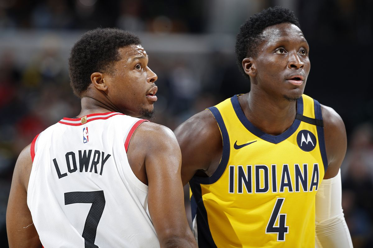 Victor Oladipo of the Indiana Pacers looks on alongside Kyle Lowry #7 of the Toronto Raptors in the first half of a game at Bankers Life Fieldhouse on February 7, 2020 in Indianapolis, Indiana.