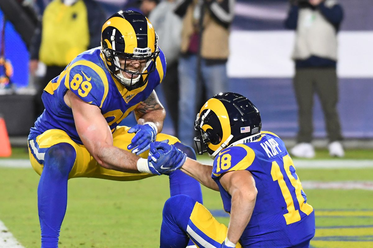 Los Angeles Rams wide receiver Cooper Kupp celebrates with tight end Tyler Higbee after a touchdown catch against the Seattle Seahawks in the first half of a NFL game at Los Angeles Memorial Coliseum.