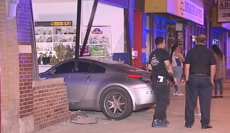 A Nissan crashed into the Fullerton Animal Clinic late Sunday in the Belmont Gardens neighborhood. | Network Video Productions