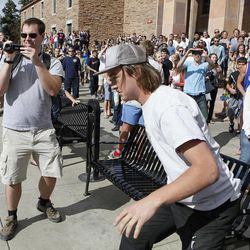 A student runs toward the police barrier on the Norlin Quad at the University of Colorado in Boulder, Colo., on Friday, April 20, 2012, at 4:20pm. He was run down by police and arrested after crossing the barrier.  Police blocked off the quad to prevent a 420 marijuana smoke out.