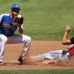 Gunnison shortstop Drew Hills tags out a Grand base runner as Gunnison defeats Grand for the 2A state baseball championship at Kearns High's Gates field on Saturday, May 13, 2017.