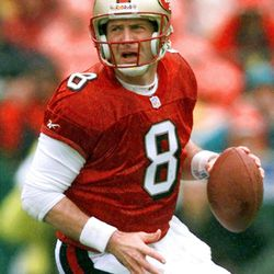 San Francisco 49ers quarterback Steve Young rolls back looking for room to pass during the opening minutes of the NFC Championship game against the Green Bay Packers in San Francisco on Jan. 11, 1998.