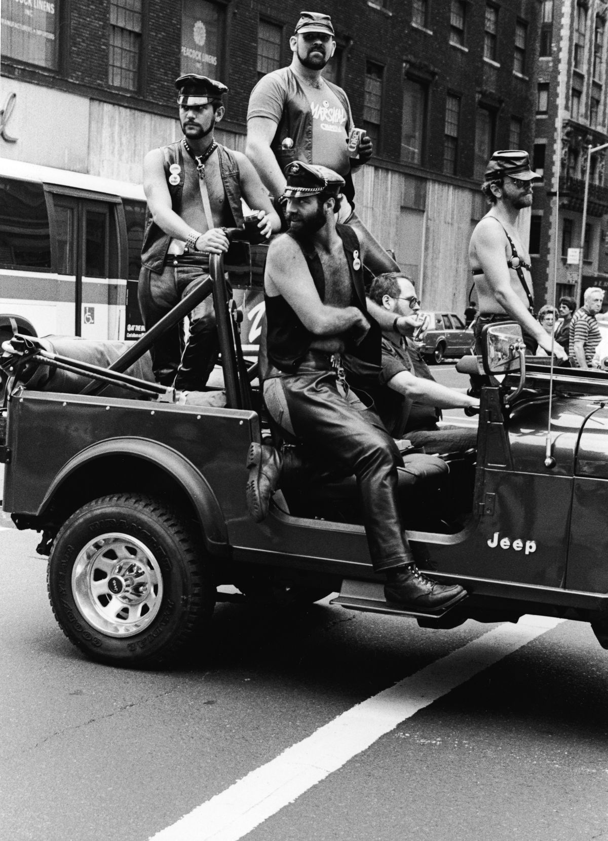 Men dressed in leather, harnesses, and leashes at New York City's Gay Pride Parade in 1980.