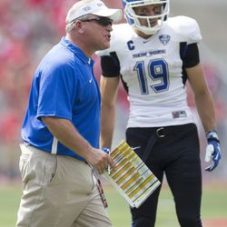 Buffalo Bulls head coach Jeff Quinn directs his offense as Buffalo Bulls wide receiver Alex Neutz (19) listens during a timeout in the game against the Ohio State Buckeyes at Ohio Stadium.