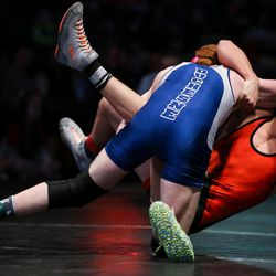 Stockton Moat, of Duchesne, and Brayson Wilcox, of Monticello, compete in the 1A 152 match at the UHSAA Wrestling State Championships at the UCCU Center in Orem on Saturday, Feb. 11, 2017.