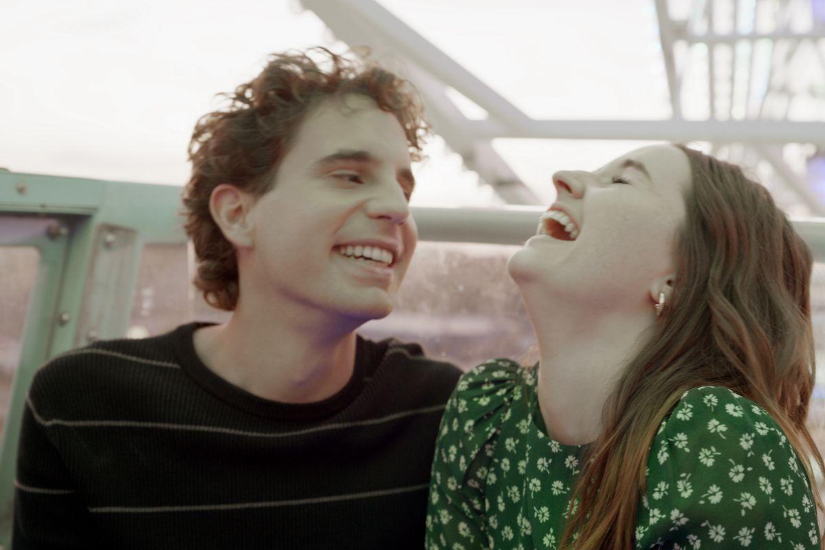 Evan and Zoey laugh on a carousel in Dear Evan Hansen