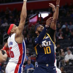Utah Jazz guard Mike Conley (10) goes to the basket against Detroit Pistons guard Bruce Brown (6) during the second half of an NBA basketball game Saturday, March 7, 2020, in Detroit.