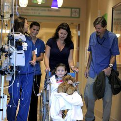 Seven-year-old Sierra Jane Downing from Pagosa Springs, Colo., is pushed to a news conference about her recovery from Bubonic Plague by her mother Darcy and father Sean Downing along with nurses  at the Rocky Mountain Hospital for Children at Presbyterian/St. Luke's Wednesday, Sept. 5, 2012, in Denver. It is believed Downing caught the Bubonic Plague from burying a dead squirrel.