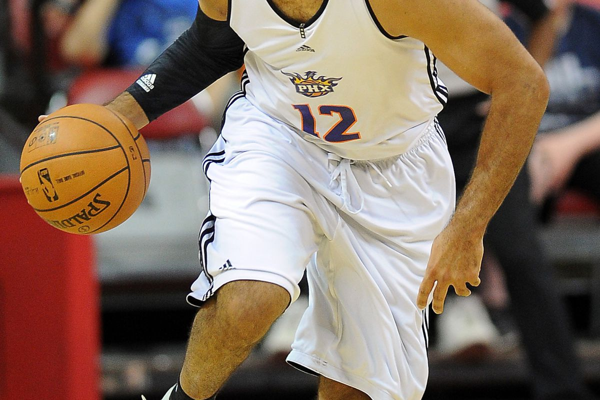 July 18, 2012; Las Vegas, NV, USA; Phoenix Suns guard Kendall Marshall (12) headed down court during the first half of the game against the New Orleans Hornets at Thomas & Mack Center. Mandatory Credit: Jayne Kamin-Oncea-US PRESSWIRE