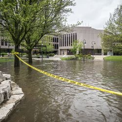 The DuPage River overflowed its banks and flooded portions of the Naperville Riverwalk Monday, May 18, 2020. It worked its way up closer to the Naperville Municipal building.